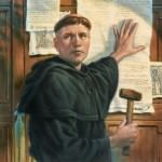 Martin Luther, dressed in black monk robes, stands in front of a wooden door with several pamphlets on it, as he nails his 95 theses to the door. He is holding a paper to the door with his left hand and holds a hammer in his right; he is looking away from the door, turned toward the viewer, looking at something to the left of the image.