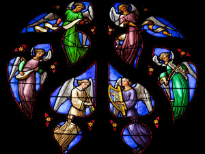 Stained glass window with images of angels