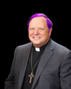 Bishop Kevin Kanouse's headshot, edited to look like his hair has been dyed purple