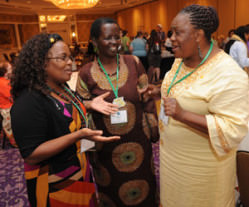 Image of three Black women talking to each other at a reception at the 2014 WELCA Triennial Gathering