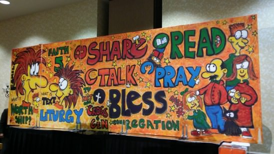 [Image description: photo of a large, colorful mural-like painting. The words SHARE, READ, TALK, PRAY, and BLESS are written prominently in the center of the artwork. On the left side of the mural is a cartoon drawing of an adult and a child, facing each other; on the right side of the mural are cartoons of adults and children standing together.]