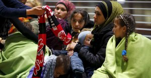 Wellwishers offer warm clothing to Syrians after they arrived on a train from Budapest's Keleti station at the railway station of the airport in Frankfurt, Germany, early morning September 6, 2015. Photo: REUTERS/Kai Pfaffenbach, courtesy of Trust.org